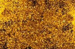 Gouden weinig onscherpe bokehcirkels op donkere achtergrond stock fotografie
