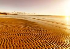Gouden zand op het strand Stock Foto's