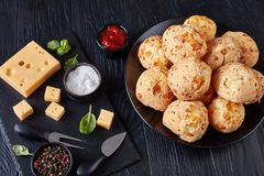 Gougeres, cheese puffs balls on a plate royalty free stock image