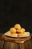 Gougeres on white plate Royalty Free Stock Photography