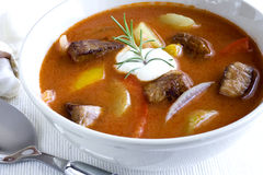 Goulash. Bowl of goulash with cream Stock Images