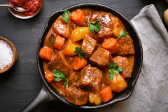 Goulash, beef stew in cast iron pan Royalty Free Stock Images