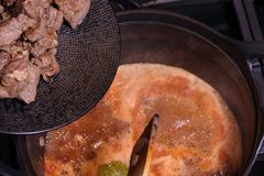 Goulash or beef stew cooking. The beef is about to be thrown into the pan royalty free stock photos
