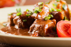 Goulash with boiled potatoes Royalty Free Stock Photos
