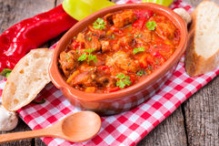 Goulash and bread Stock Photography