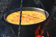 Goulash in cauldron 2 stock images