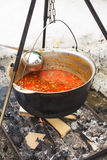 Goulash in cauldron Stock Photo