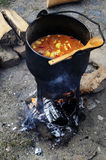 Medieval cooking. Goulash cooked over an open fire - as in the Middle Ages Stock Photos