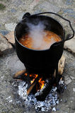 Medieval cooking. Goulash cooked over an open fire - as in the Middle Ages Stock Images