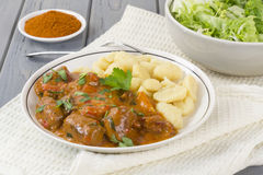 Goulash with Dumplings and Salad Royalty Free Stock Image