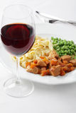 Goulash with garnish and wine Royalty Free Stock Images
