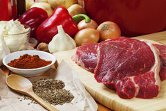 Goulash Ingredients. Ingredients for goulash. Raw beef skirt steak, onions, red capsicums, garlic, sour cream, paprika, caraway seeds and dill seeds, and Royalty Free Stock Image