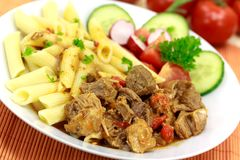 Goulash meat with penne noodles Royalty Free Stock Image