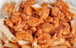 Goulash with meat pieces and pasta close up.  stock photo