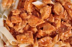 Goulash with meat pieces and pasta close up.  stock photos
