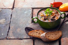 Goulash meat stew. On stone background with copy space Royalty Free Stock Photo