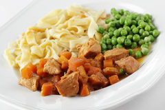 Goulash with pasta and green peas Stock Images