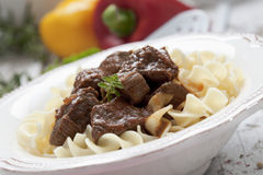 Goulash with pasta served in plate close up Stock Images