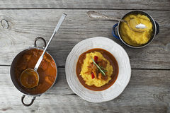 Goulash. With polenta on wooden background close up Stock Images