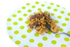 Goulash on polka dot plate Royalty Free Stock Image
