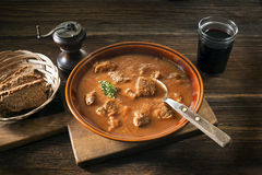 Goulash. Portion of traditional Beef stew - goulash on wooden table Royalty Free Stock Photography
