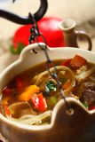 Goulash in the pot. Delicious goulash in the pot with pepper and onion Stock Images