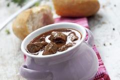 Goulash in pot white bread served Stock Image