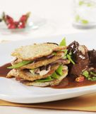 Goulash with potato pancakes Stock Photo