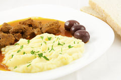 Goulash with potato puree, olives and bread Royalty Free Stock Photo