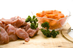 Goulash raw with carrots Stock Images