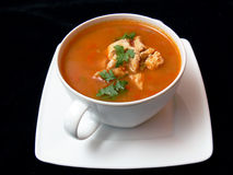 Goulash soup. White bowl of goulash soup isolated on a black background Royalty Free Stock Photos