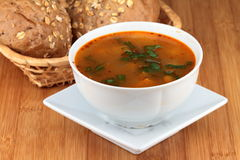 Goulash soup. On white plate with cereal rolls Royalty Free Stock Image