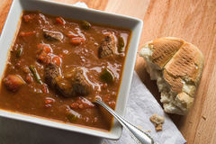 Goulash soup. Plate of hearty goulash soup with a piece of bread Royalty Free Stock Photo