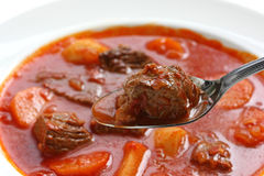 Goulash soup. Hungarian goulash soup on white background Stock Photos