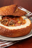 Goulash soup in a bread bowl Stock Photography