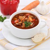 Goulash soup with meat, baguette and paprika healthy eating Stock Photography