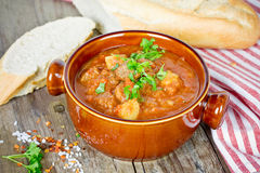 Goulash soup on wooden table Royalty Free Stock Photos