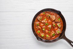 Free Goulash Traditional Homemade Hungarian Beef Meat Stew Soup Food With Spicy Gravy In Cast Iron Pan Skillet Royalty Free Stock Images - 92480749