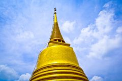 Gould pagoda and biue sky. In the Thailand stock images