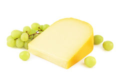Gouda cheese with grapes Stock Photo