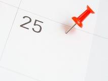 Goupille rouge goupillée la 25ème date du mois Photos stock