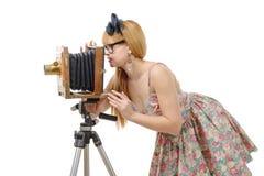 Goupille sexy vers le haut de fille avec le vieil appareil-photo en bois de photo image stock