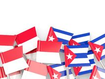 Goupilles avec des drapeaux de l'Indon?sie et du Cuba d'isolement sur le blanc illustration libre de droits