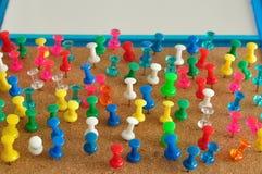 Goupilles colorées de poussée Photographie stock libre de droits