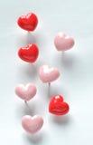 Goupilles en forme de coeur de poussée Photographie stock