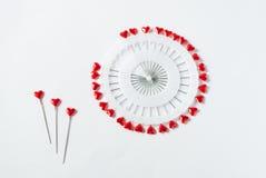 Goupilles en forme de coeur sur le blanc Images libres de droits