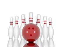 Goupilles et boule de bowling sur un fond blanc Photographie stock libre de droits