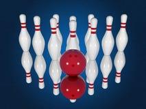 Goupilles et boule de bowling sur un fond bleu Images stock