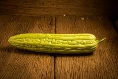 gourd bitterroot на старое деревянном стоковая фотография