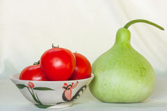 Gourd, tomatoes in a bowl tiles Royalty Free Stock Images